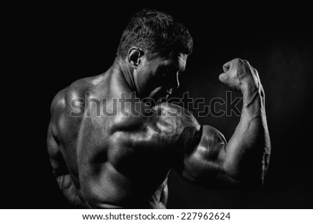 Strong Athletic Man Fitness Model Torso showing big muscles. monochrome image - stock photo