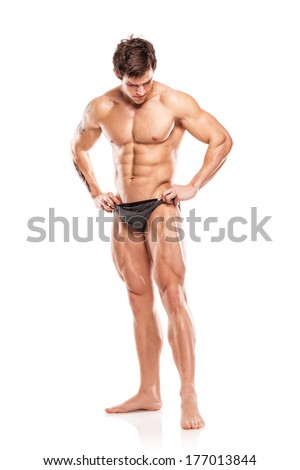 Strong Athletic Man Fitness Model Torso showing naked muscular body and legs isolated on white background - stock photo
