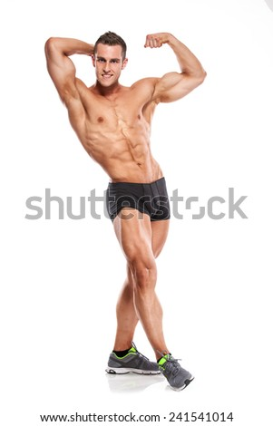 Strong Athletic Man Fitness Model Torso showing six pack abs. and posing