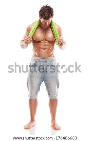 Strong Athletic Man Fitness Model Torso showing six pack abs. holding towel - stock photo