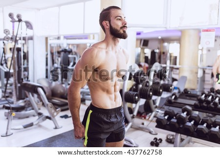 strong athletic man flexing torso