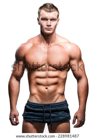 Strong athletic man posing in studio