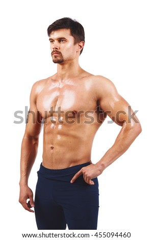 Strong Athletic Man showing muscular body and sixpack abs over white