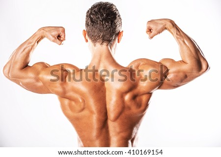 Strong Athletic Man showing muscular body and sixpack abs over white background.Muscular bodybuilder guy doing exercises with dumbbells over white background.Muscular man on white background - stock photo
