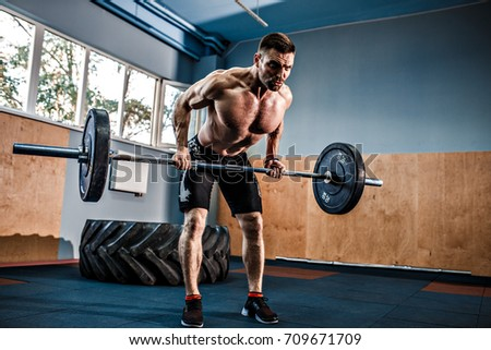Strong bearded tattooed man crossfit gym stock photo 709671709 strong bearded tattooed man at a crossfit gym lifting a barbell platinumwayz