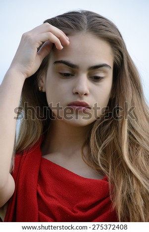 strong beauty, woman in red - stock photo
