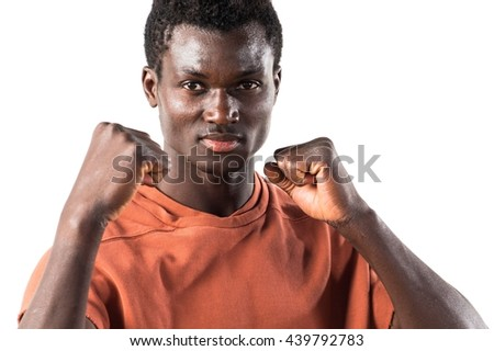 Strong black man giving a punch