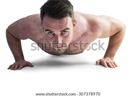 Strong bodybuilder doing press up on white background