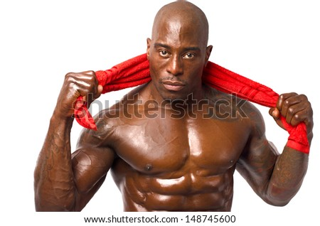 Strong bodybuilder man with perfect abs, pecs shoulders,biceps, triceps and chest holding a red towel. Isolated on white background.