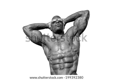 Strong bodybuilder man with perfect abs, shoulders,biceps, triceps and chest - stock photo