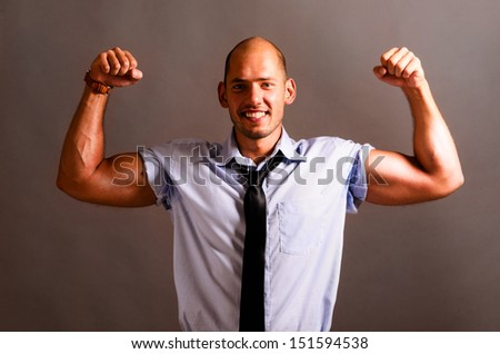 strong business man is showing his biceps - stock photo