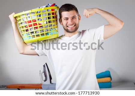 Strong cheerful husband during nice daily duties - stock photo
