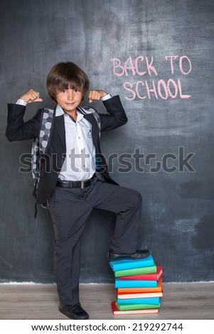 Strong cheerful school boy - stock photo