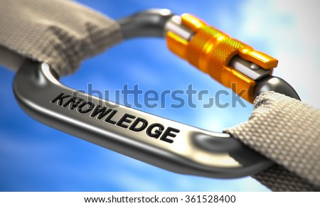 Strong Connection between Chrome Carabiner and Two White Ropes Symbolizing the Knowledge. Selective Focus. - stock photo