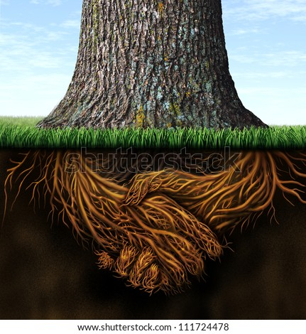 Strong deep business roots as a tree trunk with the root in the shape of a hand shake as a symbol of unity trust and integrity in finance and relationships. - stock photo