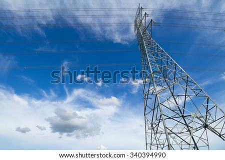 strong electric power lines against blue sky