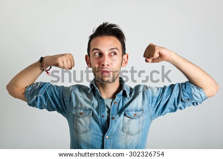 Strong funny man - stock photo