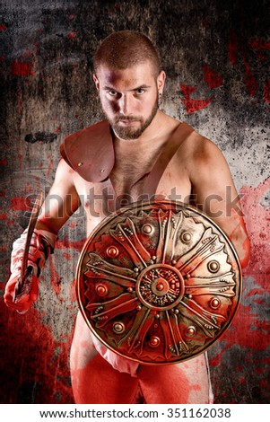strong gladiator isolated in dark background - stock photo