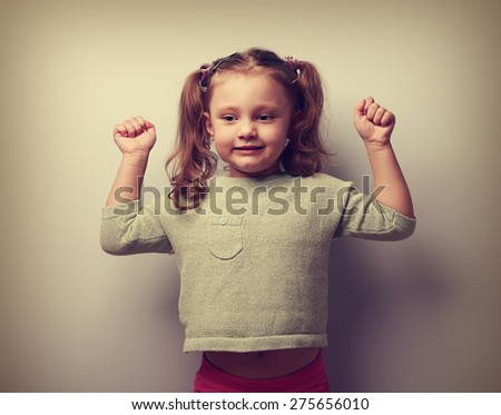 Strong happy successful girl showing muscular. Health concept. Vintage closeup portrait - stock photo