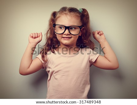 Strong happy successful girl showing muscular in glasses. Healthy child lifestyle. Closeup vintage portrait