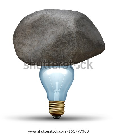 Strong idea concept as a creative strength symbol of determination with a large rock or boulder on top of a light bulb as a strong innovative business solution overcoming challenges and adversity. - stock photo
