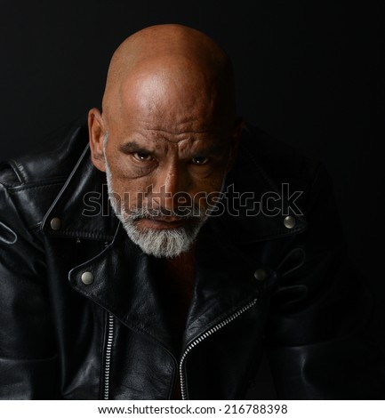 Strong Image of a very Tough Man on Black - stock photo