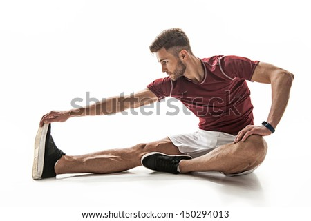 Strong male athlete training his body