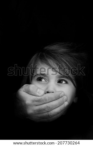 Strong male hands cover little girl face with emotional stress, pain, afraid, call for help, struggle, terrified expression.Concept Photo of abduction, missing, kidnapped,victim, hostage, abused child - stock photo