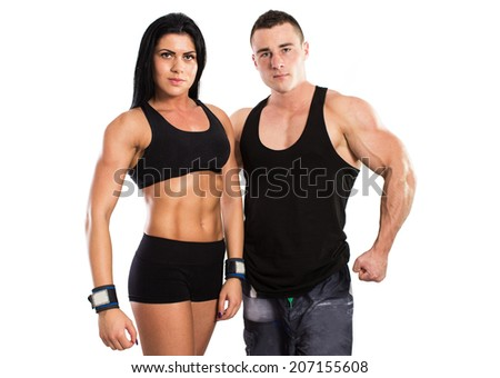 Strong man and a woman posing on a black background