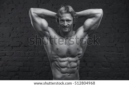 Strong man. Close up of male muscular body. Black and white image.