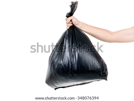 Strong man hand carry garbage in plastic bag for eliminate on the white background - stock photo