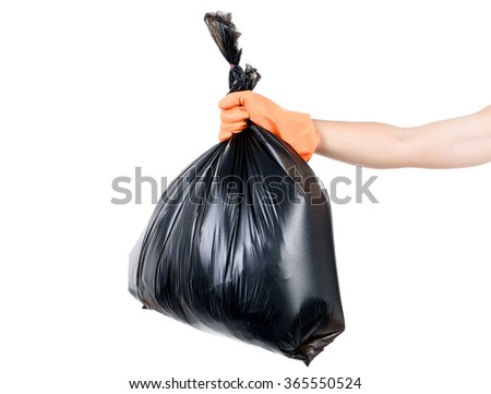 Strong man hand in orange gloves carry garbage in plastic bag for eliminate on the white background - stock photo