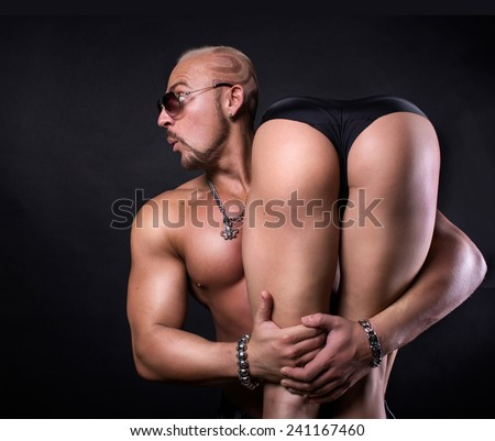 Strong man hold woman on shoulder. - stock photo