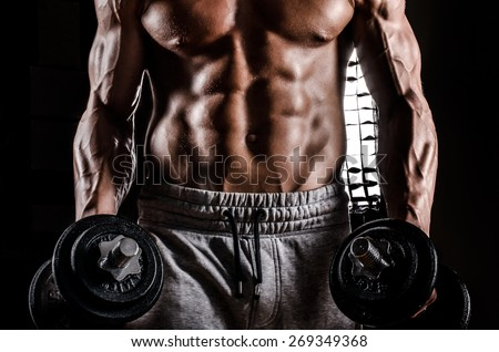 Strong Man Male Bodybuilder in Action with weights - stock photo