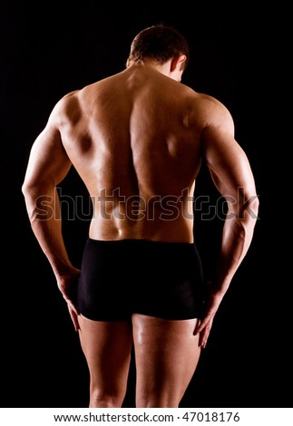 strong man on dark background - stock photo