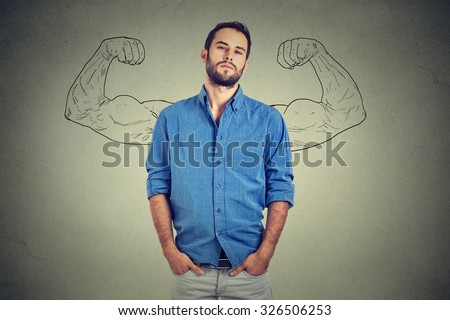 Strong man, self confident young entrepreneur standing isolated on gray wall background. Arrogant bold self-important uppity snobbish stuck up man