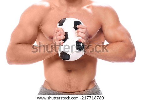 Strong man squeezing soccer ball on a white background - stock photo