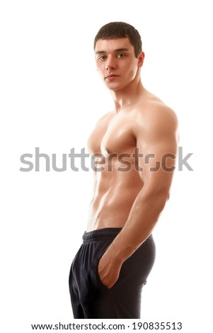 Strong man with a healthy body isolated over white