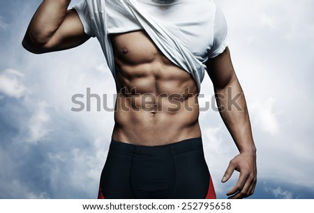 Strong man with athletic body - stock photo