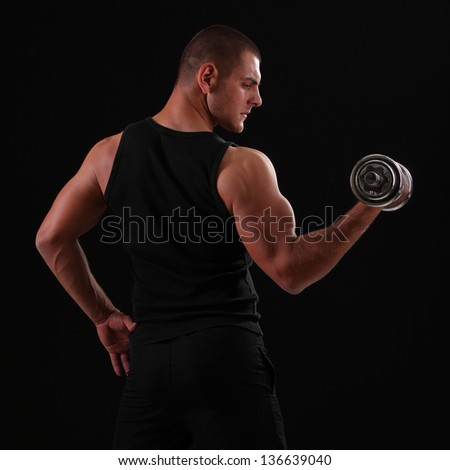 strong man with dumbbells in his hands - stock photo