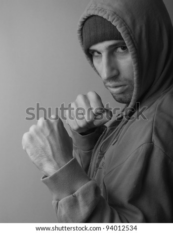 strong man with his fists ready to fight - stock photo