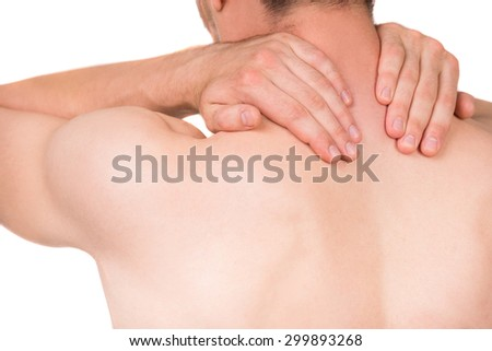 Strong man with neck pain over white background. Back view. Close-up. - stock photo