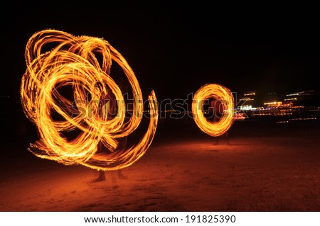 Strong Men Juggling Fire in Thailand - Fire Dancers - stock photo