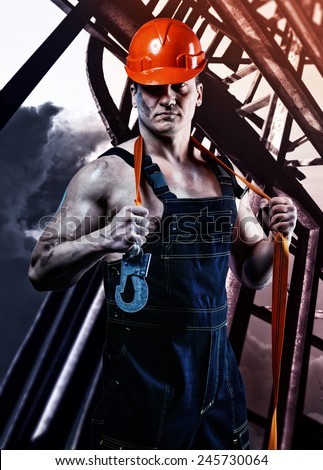 Strong men worker in the helmet - stock photo