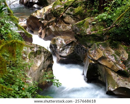 Strong mountain stream and beautiful rocks - stock photo