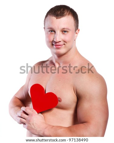 Strong muscular man holding red valentine's heart at white background - stock photo