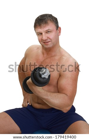 Strong Male Athlete Training With Dumbbells Stock Photo