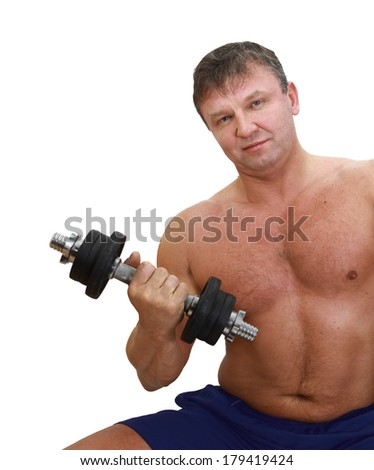Strong muscular man with a naked torso sits with barbell in hand isolated on white background
