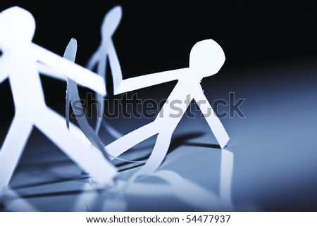 strong paper team save man from problem - stock photo