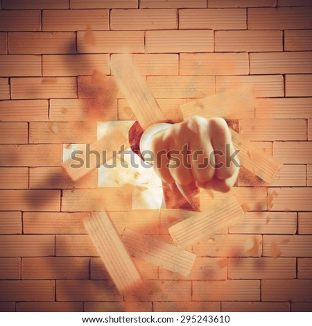 Strong punch that breaks a brick wall - stock photo